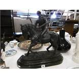 A bronze sculpture of a jockey and horse