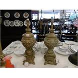 A pair of urn table lamps with shades