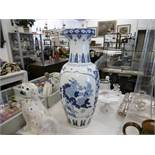 An oriental blue and white vase height 65cm