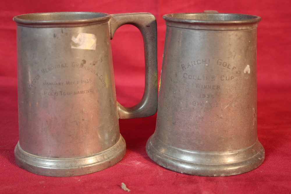 Lot 23 - A set of four copper graduated jugs and two pewter