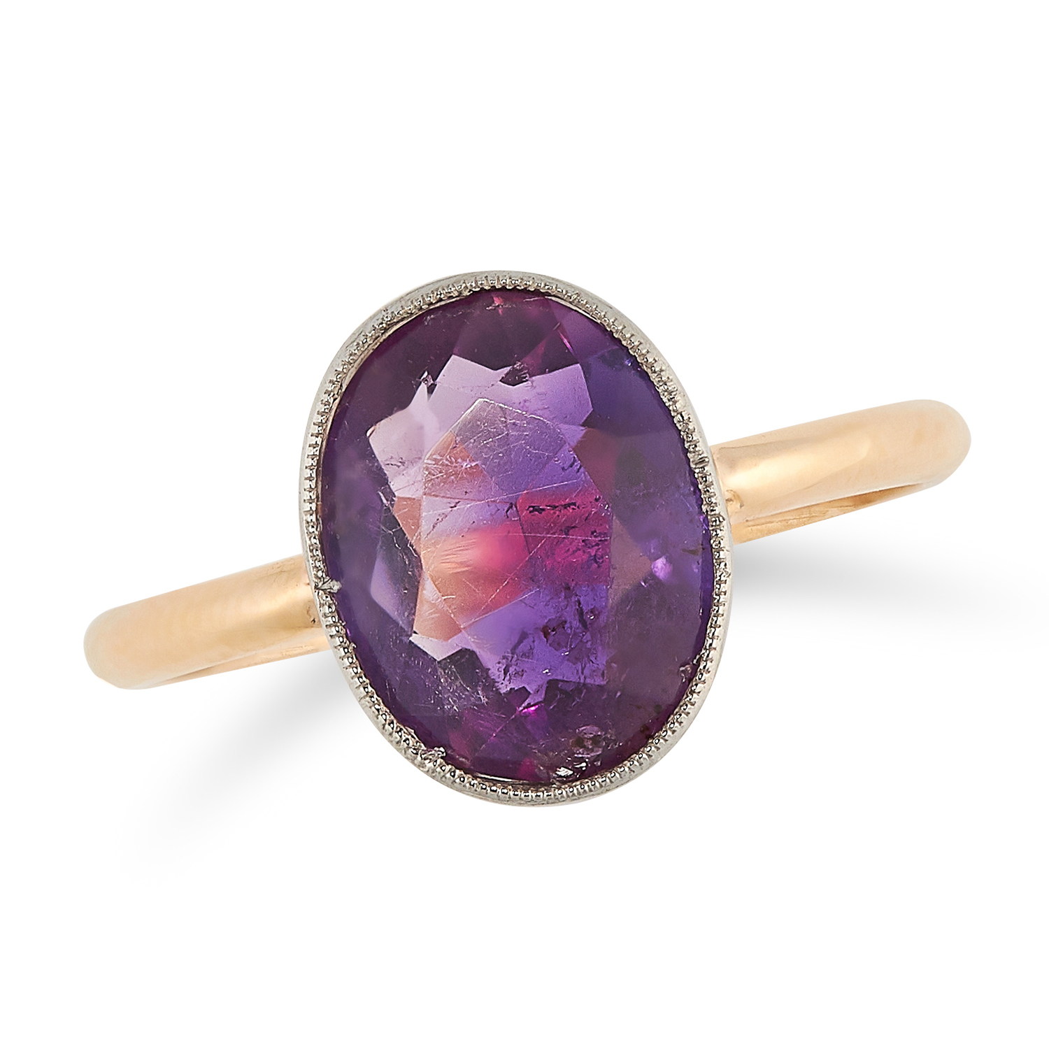 Los 13A - AN AMETHYST RING set with an oval cut amethyst to a plain band, size O / 7, 2.5g.