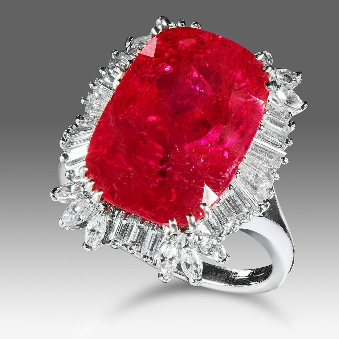 Los 11A - A BURMA NO HEAT RUBY AND DIAMOND RING set with a cushion cut ruby of 14.67 carats encircled by a