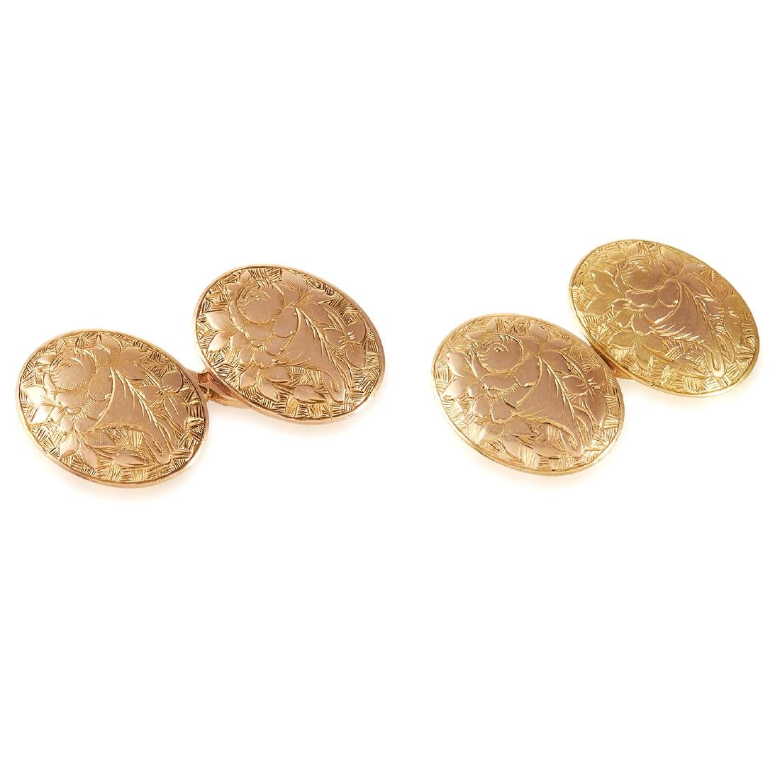 Los 22 - A PAIR OF ANTIQUE CUFFLINKS the oval faces decorated in floral engraved designs, 7.1g.