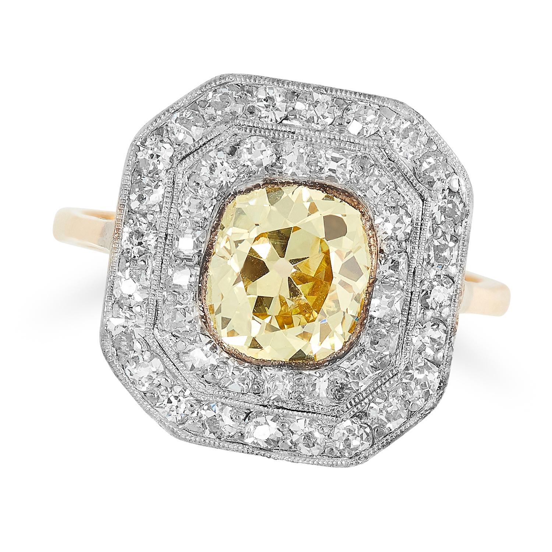 A FANCY YELLOW DIAMOND AND DIAMOND CLUSTER RING set with a fancy yellow cushion cut diamond of 1.