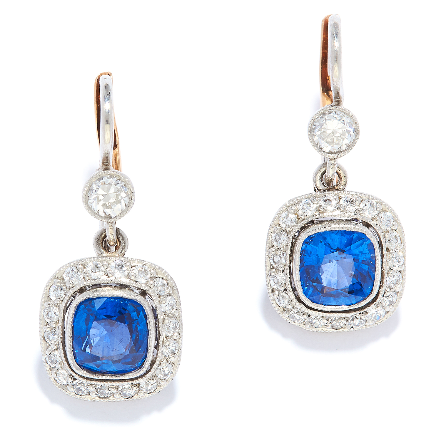 Los 26 - SAPPHIRE AND DIAMOND CLUSTER EARRINGS in 18ct gold or platinum, each set with a cushion cut sapphire