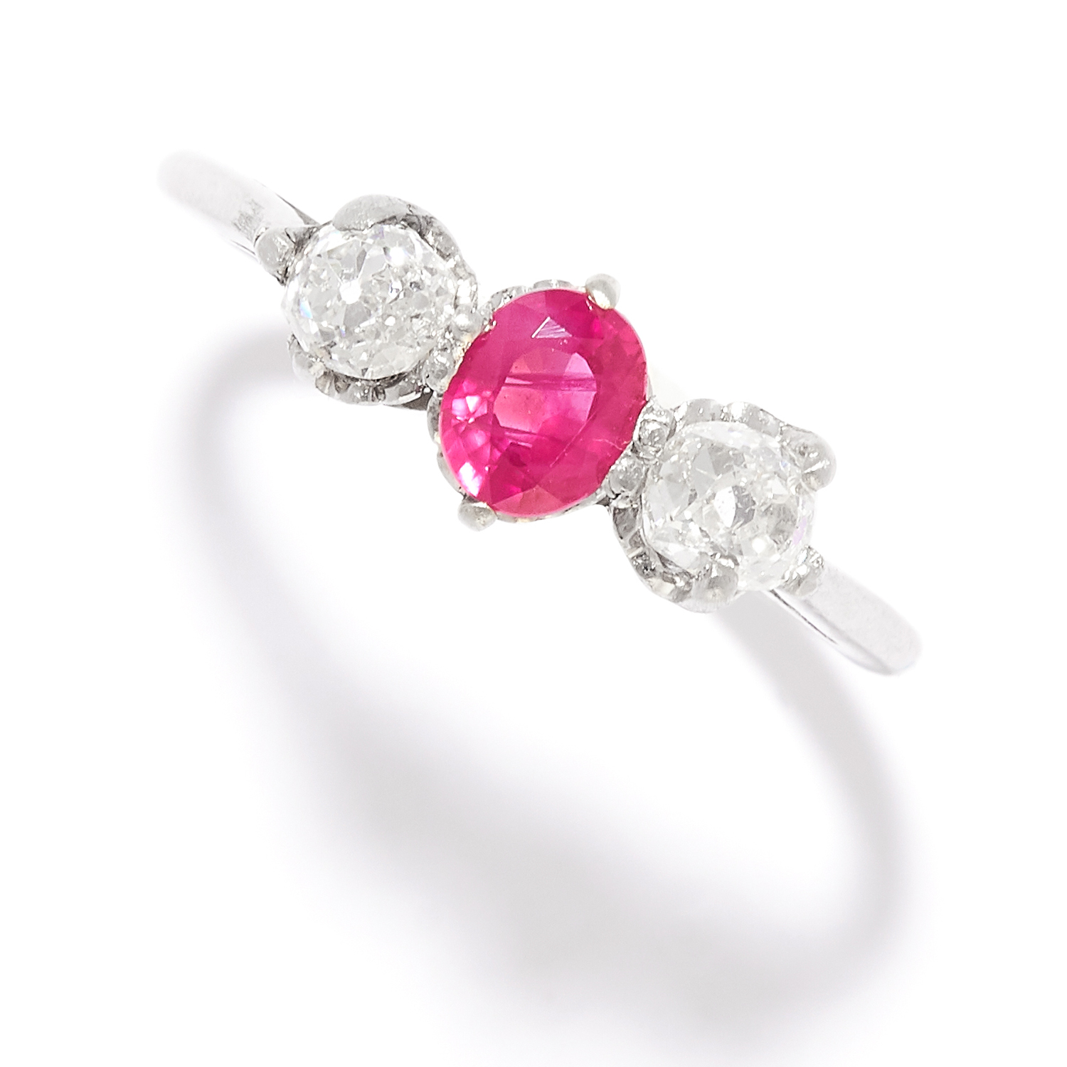 Los 44 - RUBY AND DIAMOND THREE STONE RING in gold or platinum, set with an oval cut ruby between two old cut