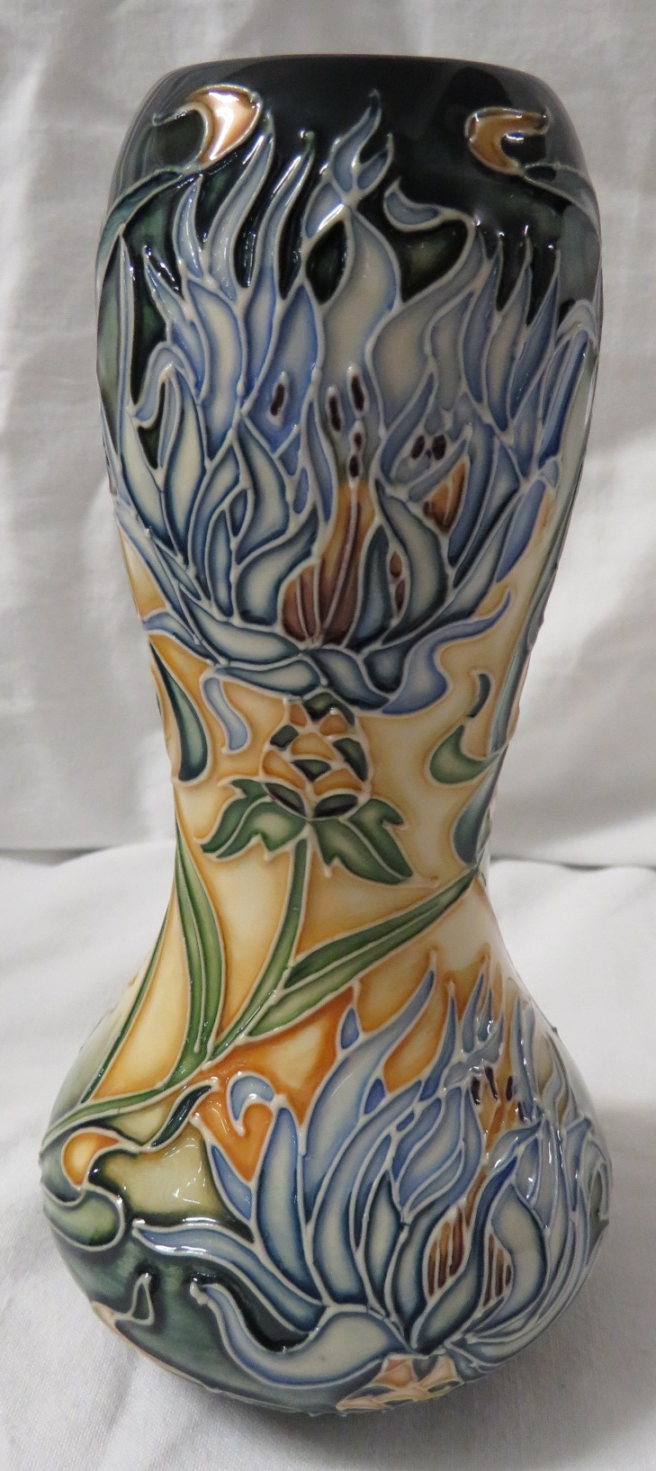Lot 7 - Moorcroft pottery Montana baluster vase with bulbous neck, dark green ground graduating to yellow,