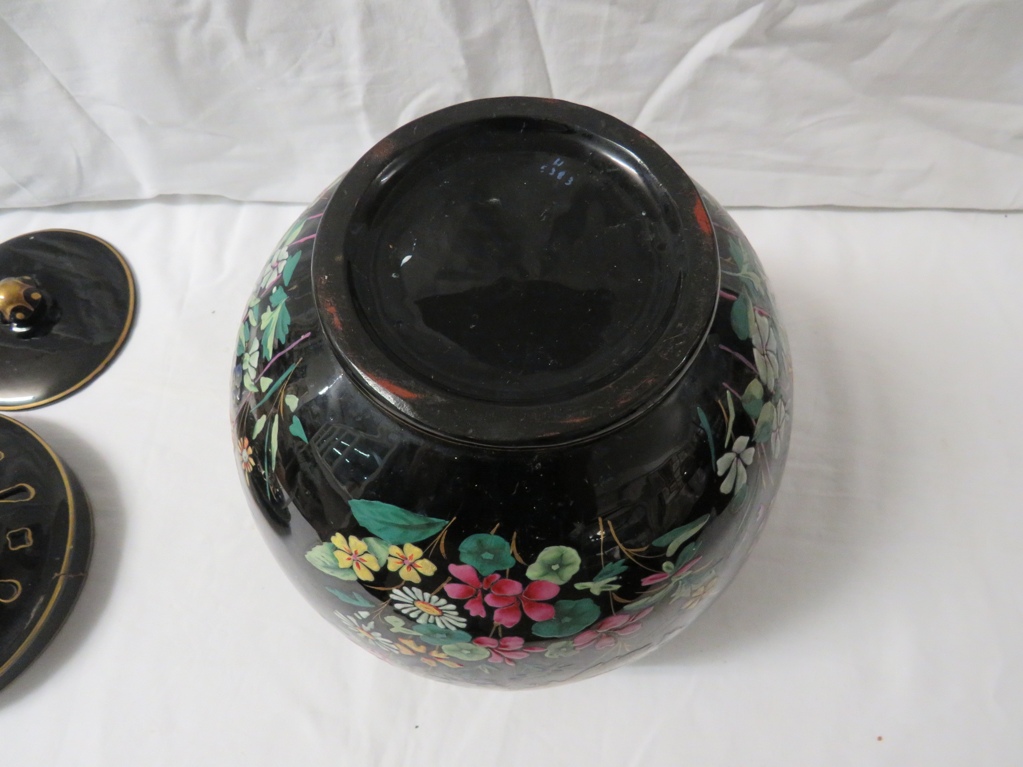 Lot 53 - A large ovoid china pot pourri, black ground, transfer and painted enamel decoration of birds