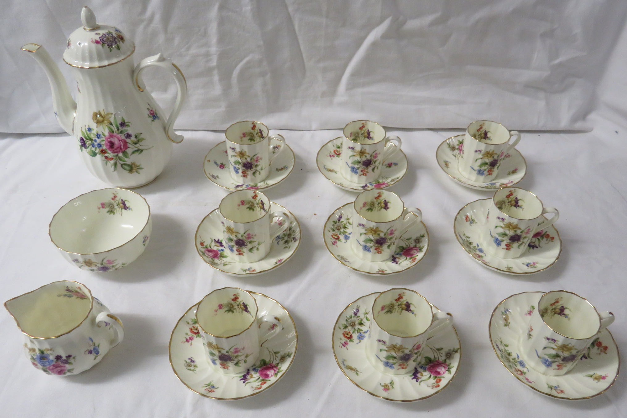 Lot 54 - Royal Worcester Roanoke nine setting fluted coffee service with coffee pot, sugar bowl and milk jug,