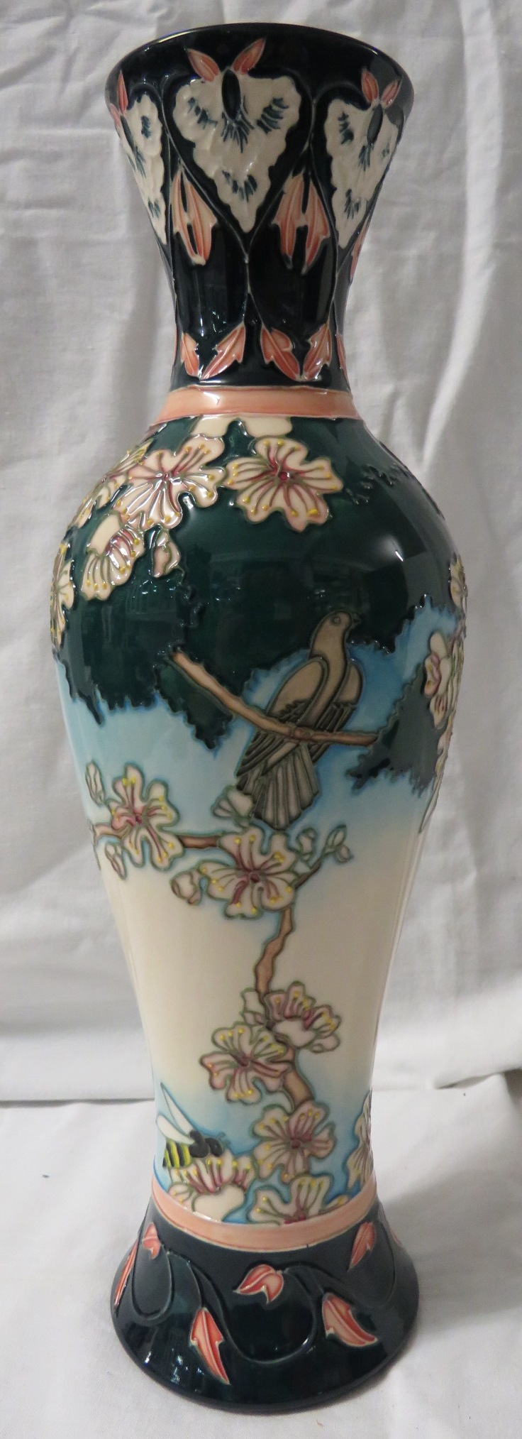 Lot 23 - Moorcroft Pottery five star members slender baluster vase 'Cuckoo Song', decorated with bird in