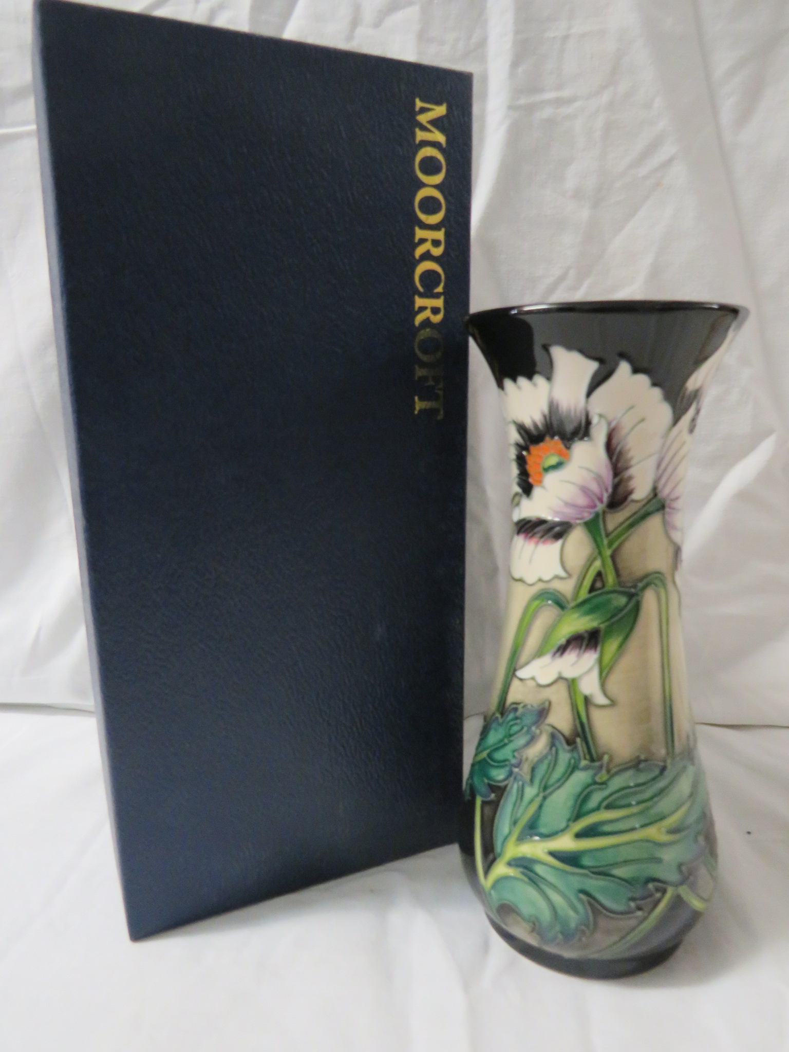 Lot 14 - Moorcroft pottery four star members baluster vase, buff ground, black at neck and foot, tube lined