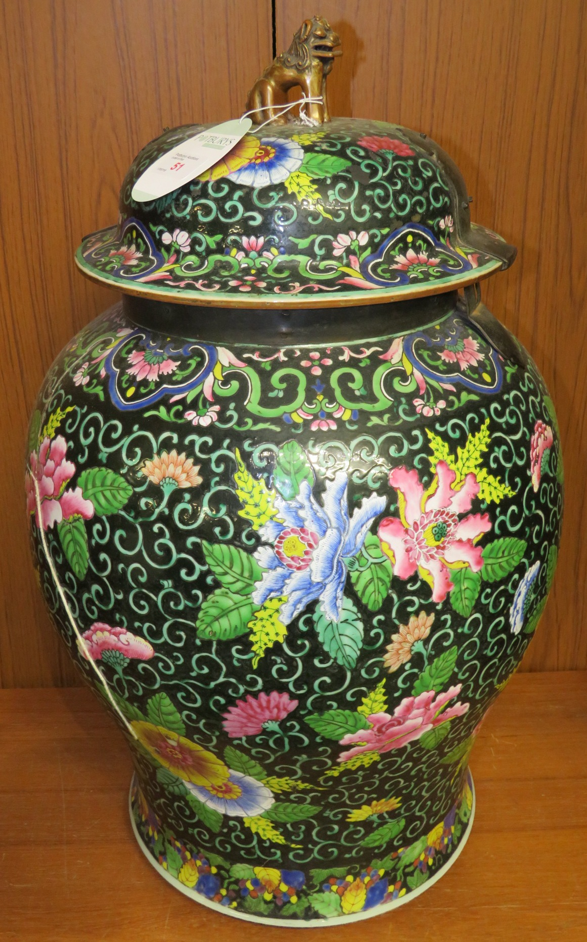 Lot 51 - A large Chinese porcelain famille noire lidded vase, enamelled with pink, blue and yellow flowers