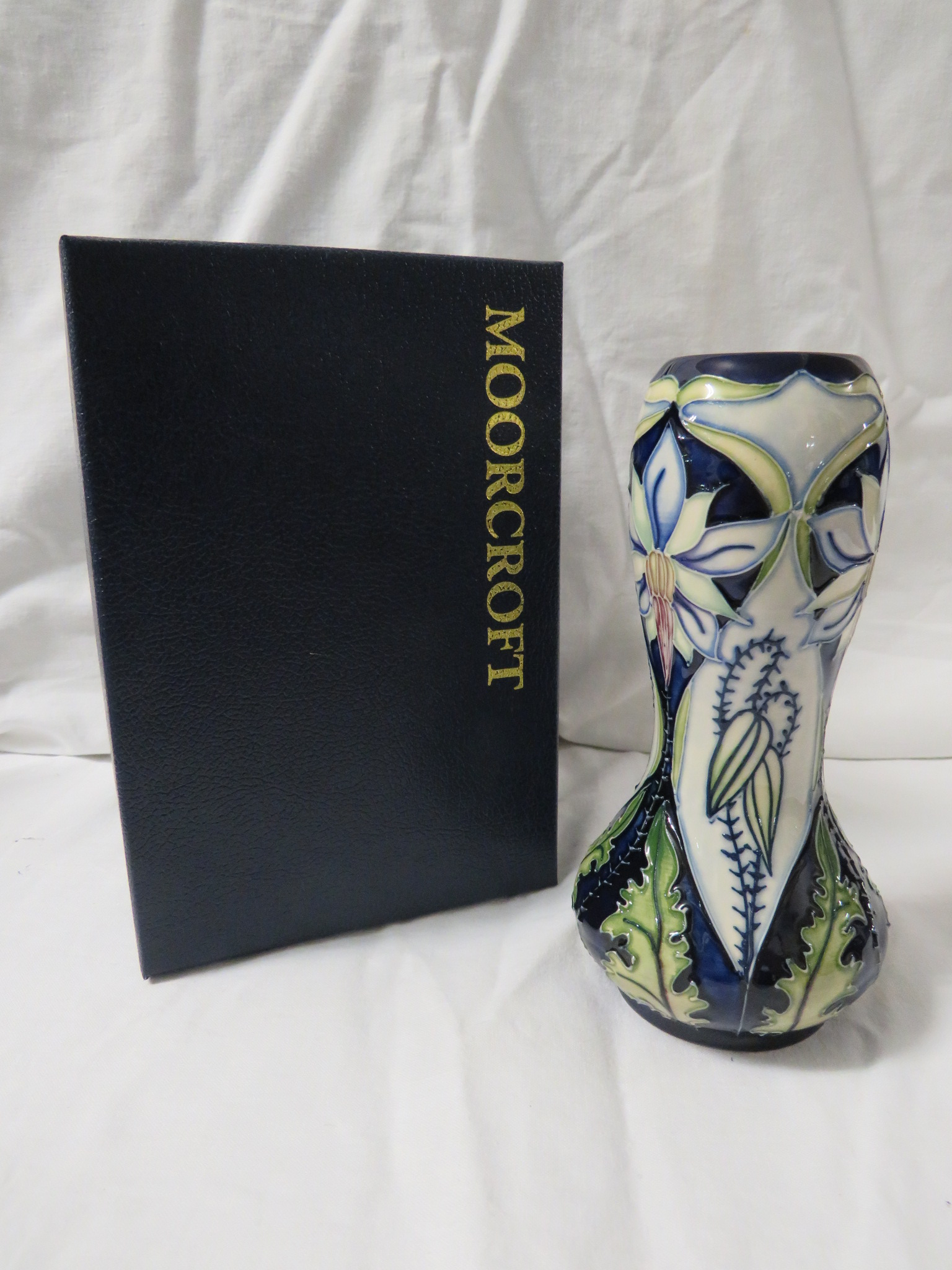 Lot 8 - Moorcroft pottery Meadow Star baluster vase with bulbous neck, dark blue ground, tube lined