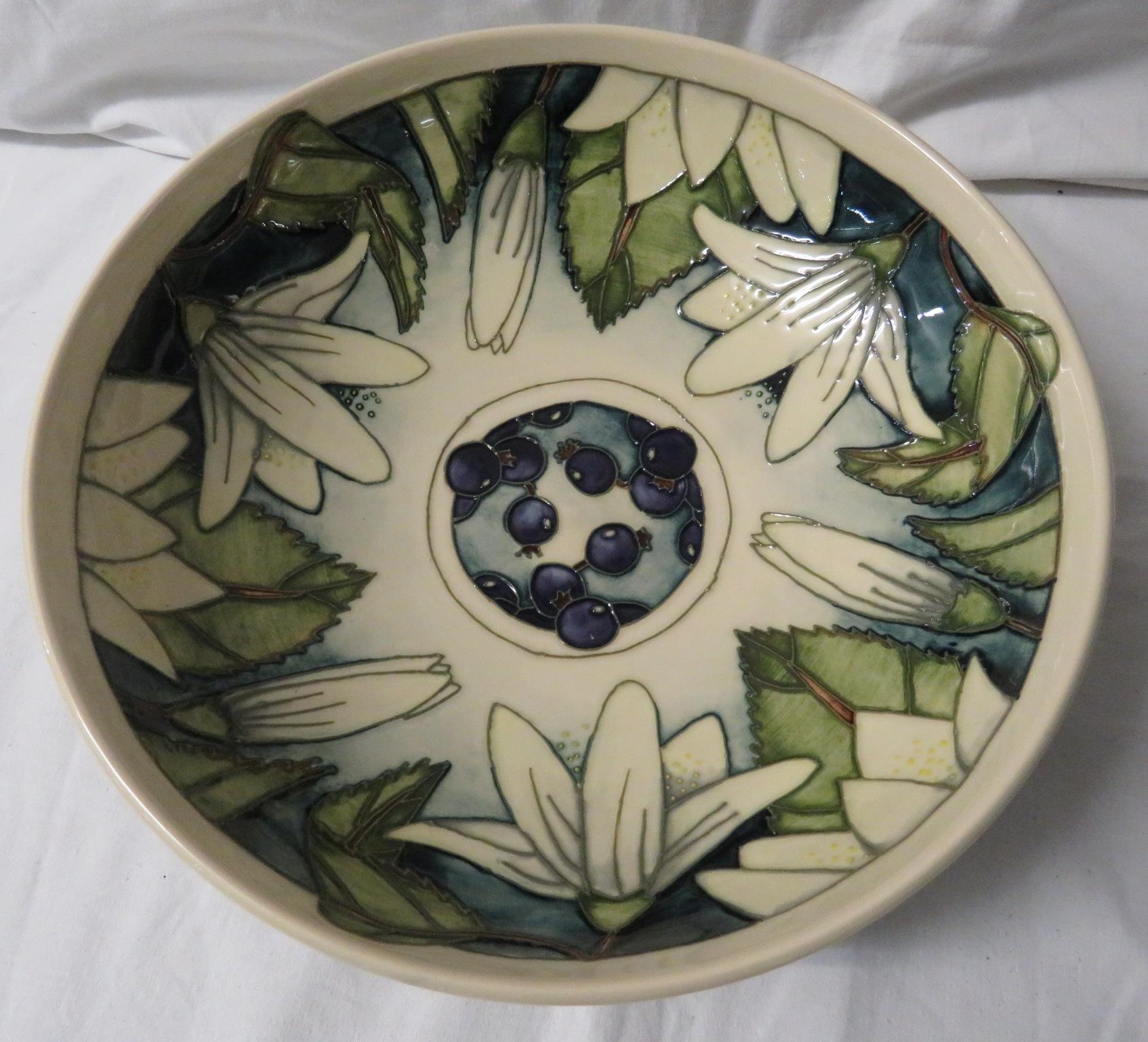 Lot 24 - Moorcroft pottery Juneberry bowl designed by Angela Davenport, cream ground, tube lined decoration
