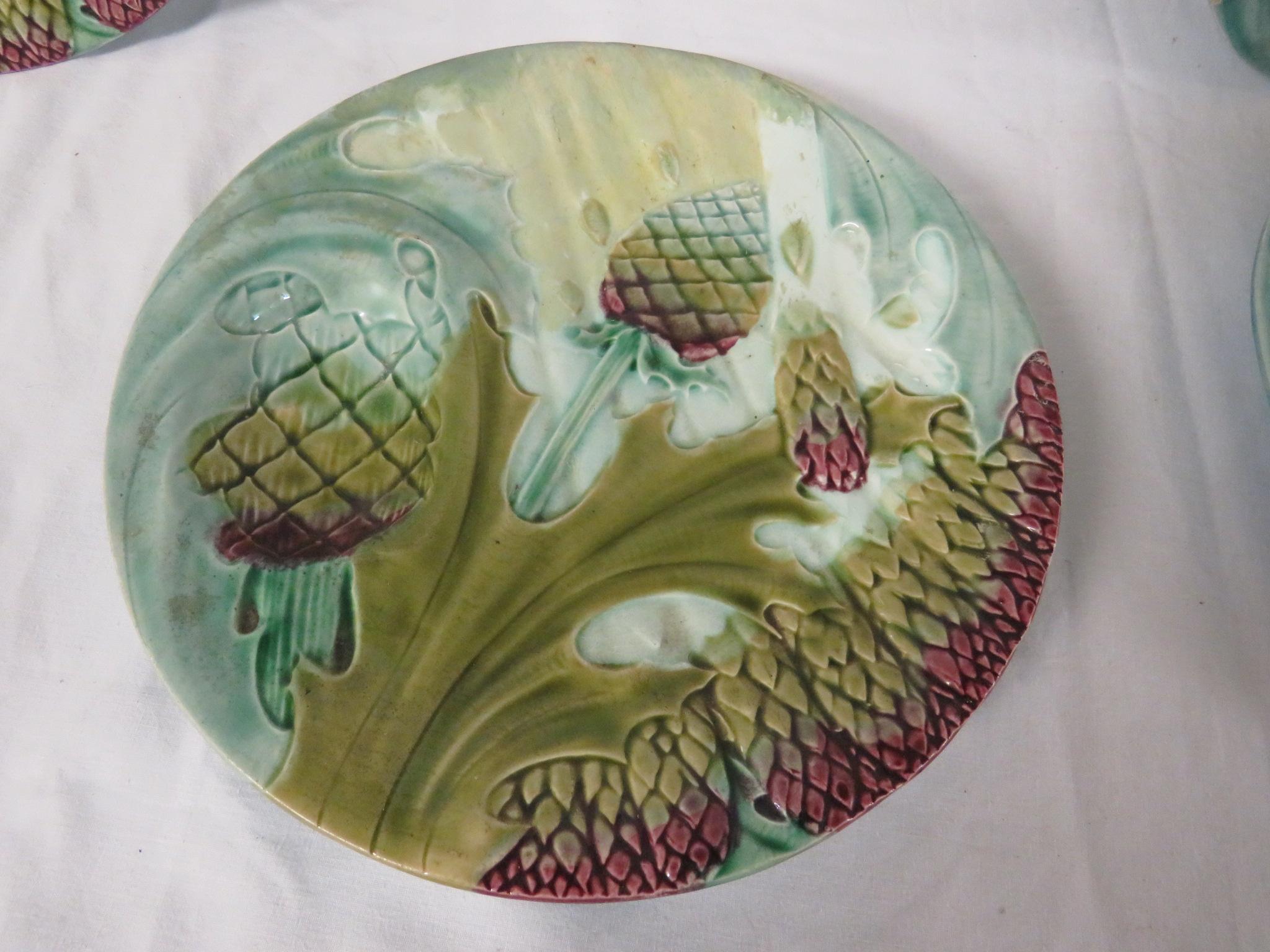 Lot 56 - Six majolica asparagus plates, diameter 23cm, stamped Depose Luneville