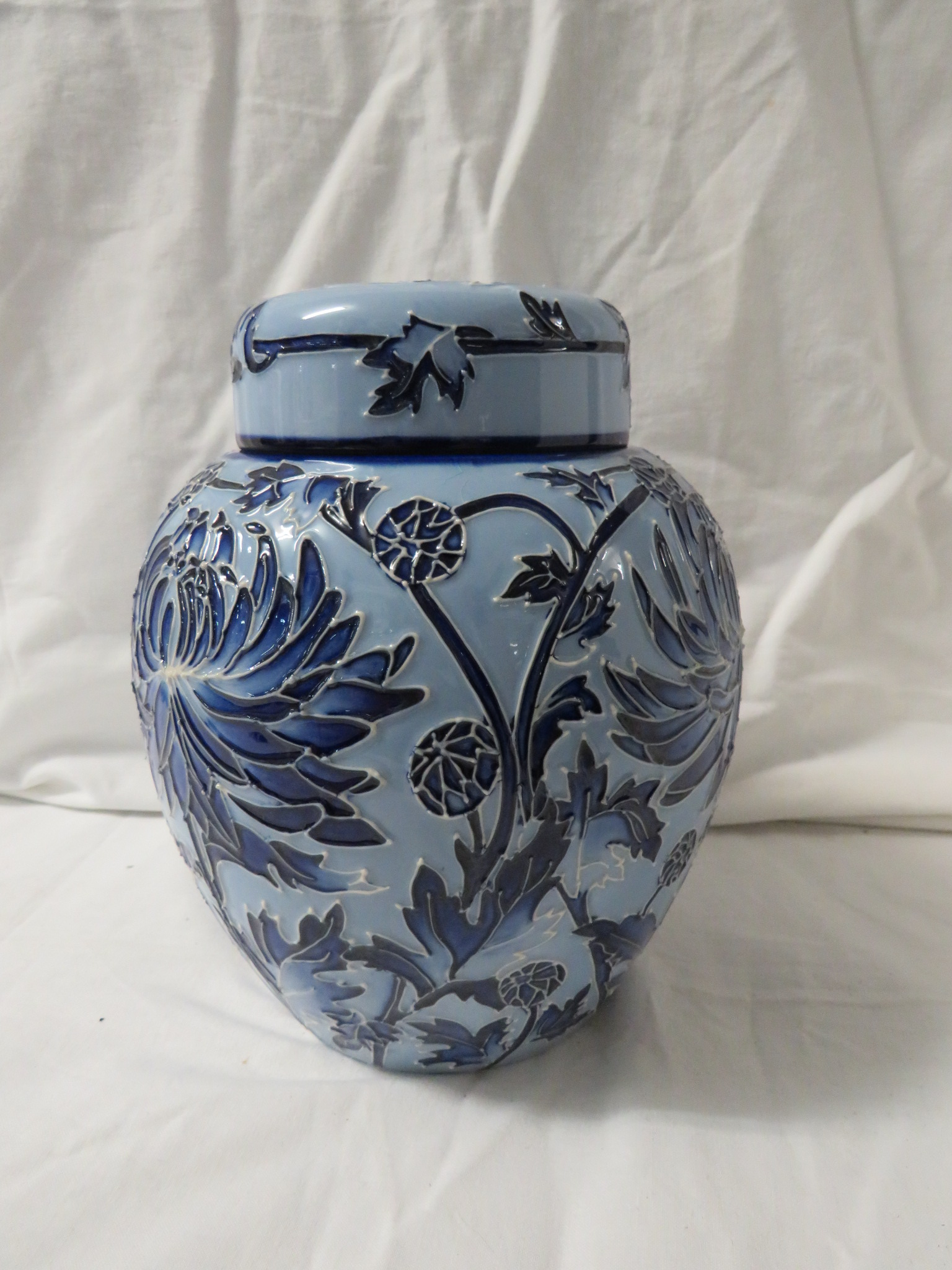 Lot 13 - Moorcroft pottery ginger jar with cover in the style of Macintyre Florian ware, pale blue ground