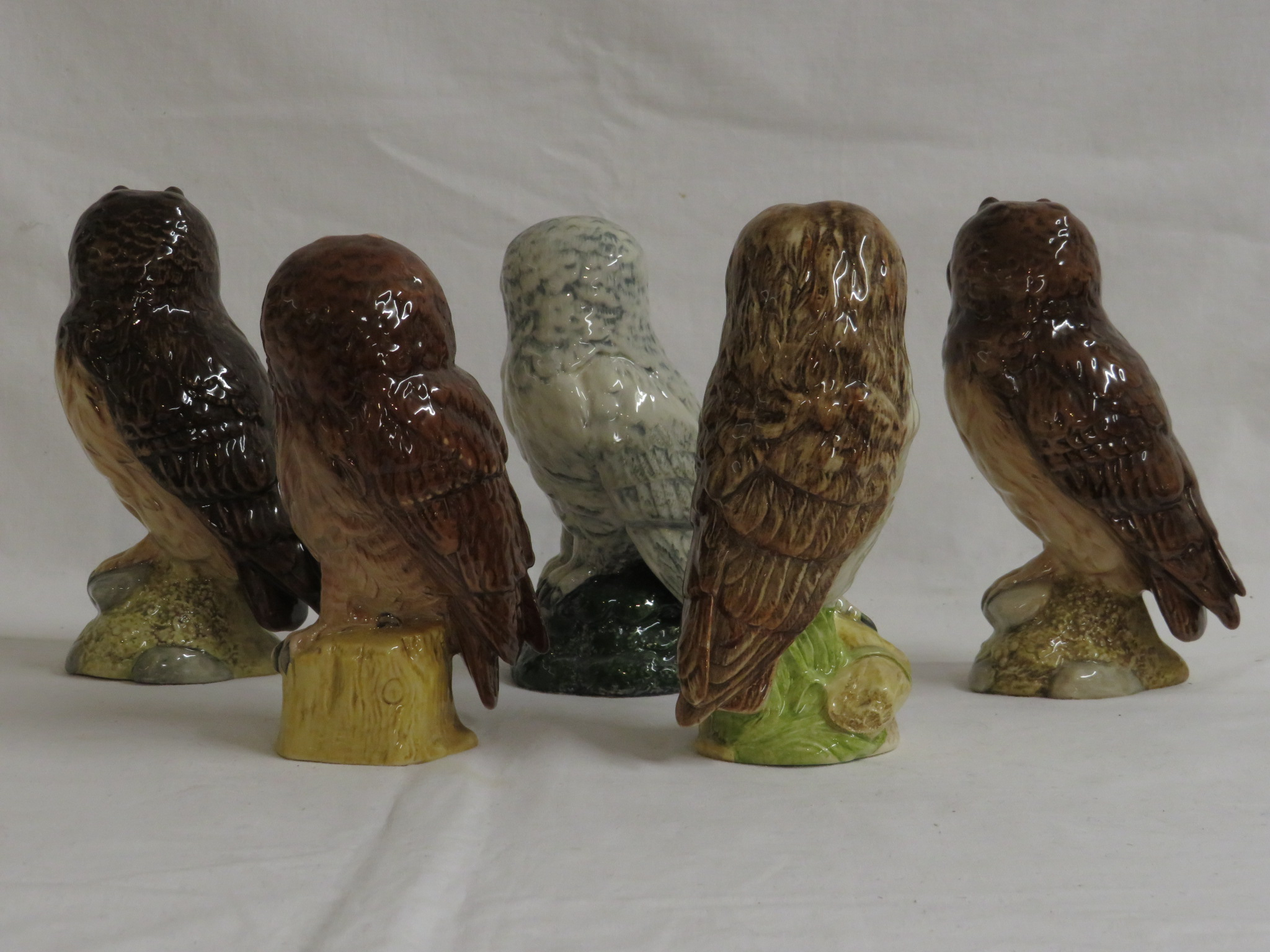 Lot 58 - Five Royal Doulton Whyte & Mackay 200ml whisky decanters modelled by John G. Tongue as owls with