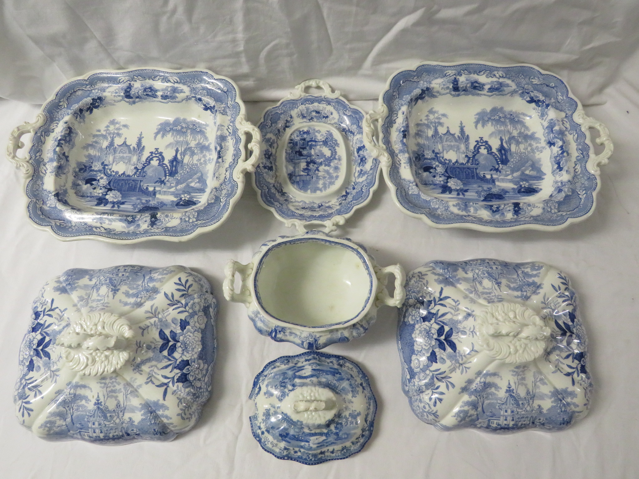 Lot 55 - Pountney and Allies blue and white transfer decorated Sicilian pattern pottery dinner ware - a
