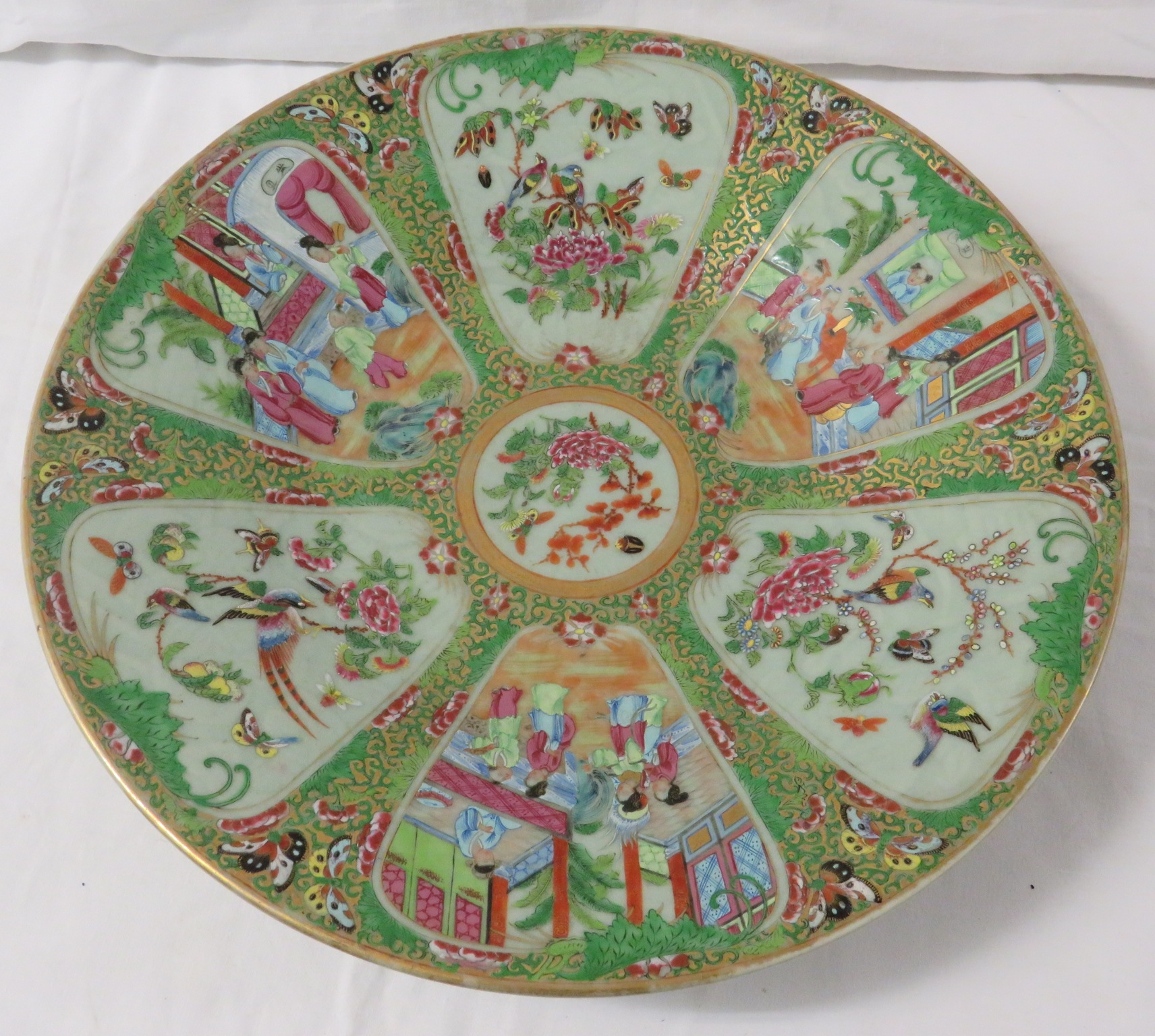 Lot 52 - Chinese famille rose porcelain circular dish, celadon ground with dark green scrolled foliage and