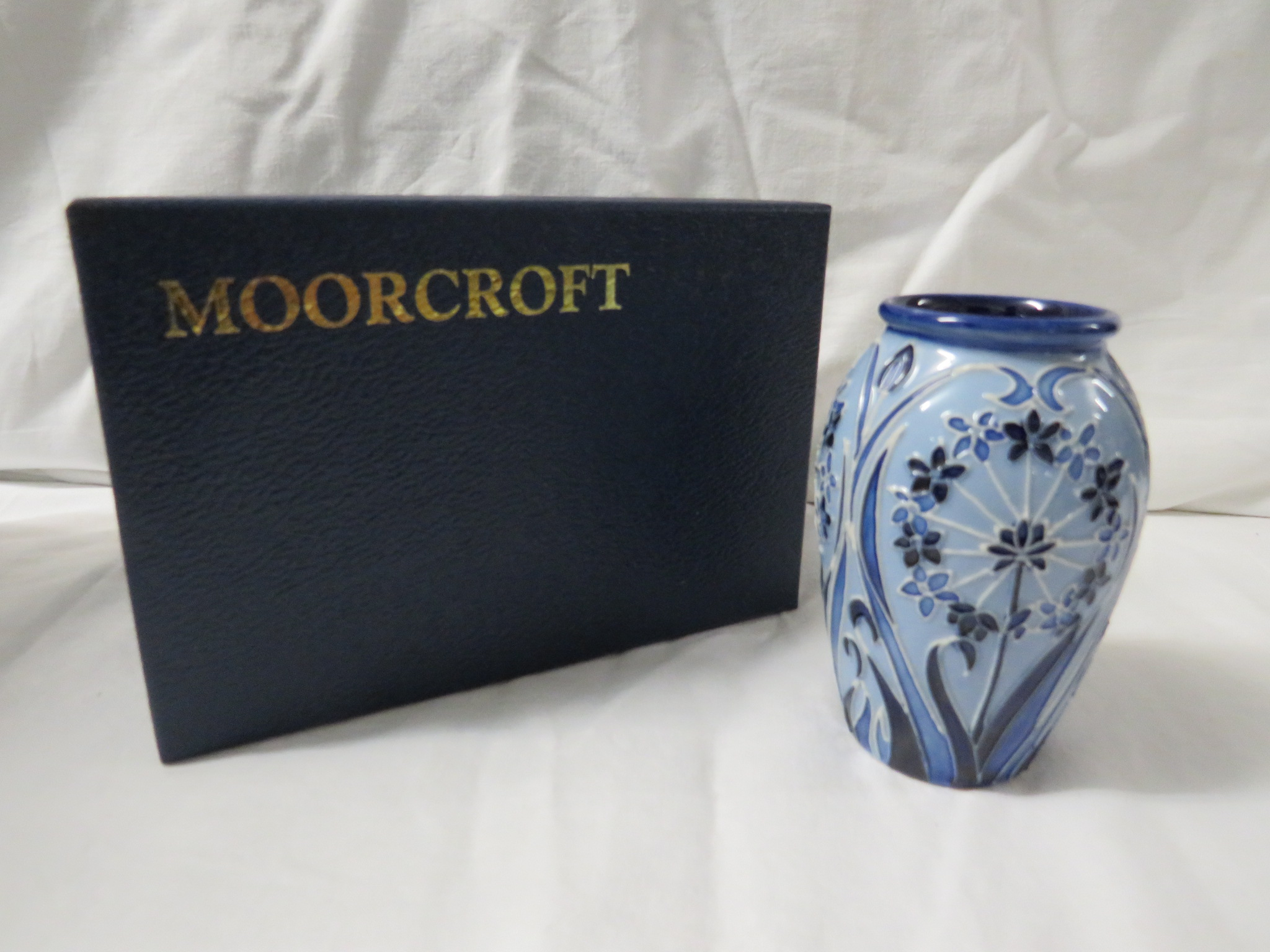 Lot 12 - Moorcroft pottery ovoid vase Leila in the style of Macintyre florian ware, pale blue ground, tube