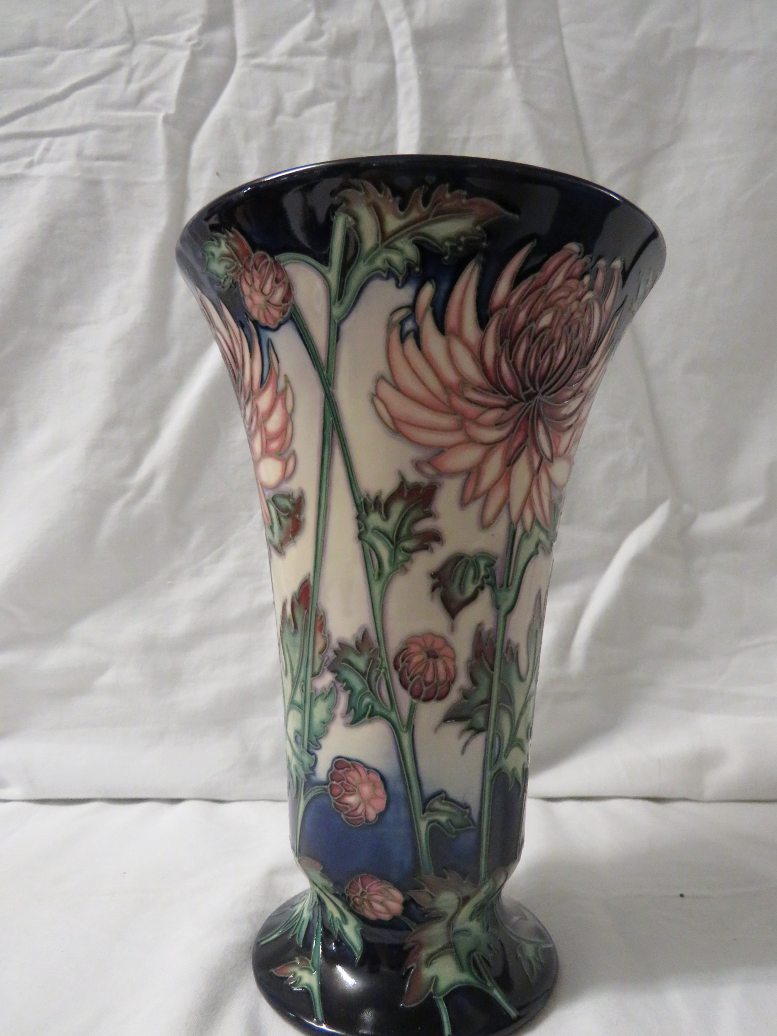 Lot 21 - Moorcroft pottery Connoisseur Collection pink eustoma vase of flared form, cream ground, dark blue