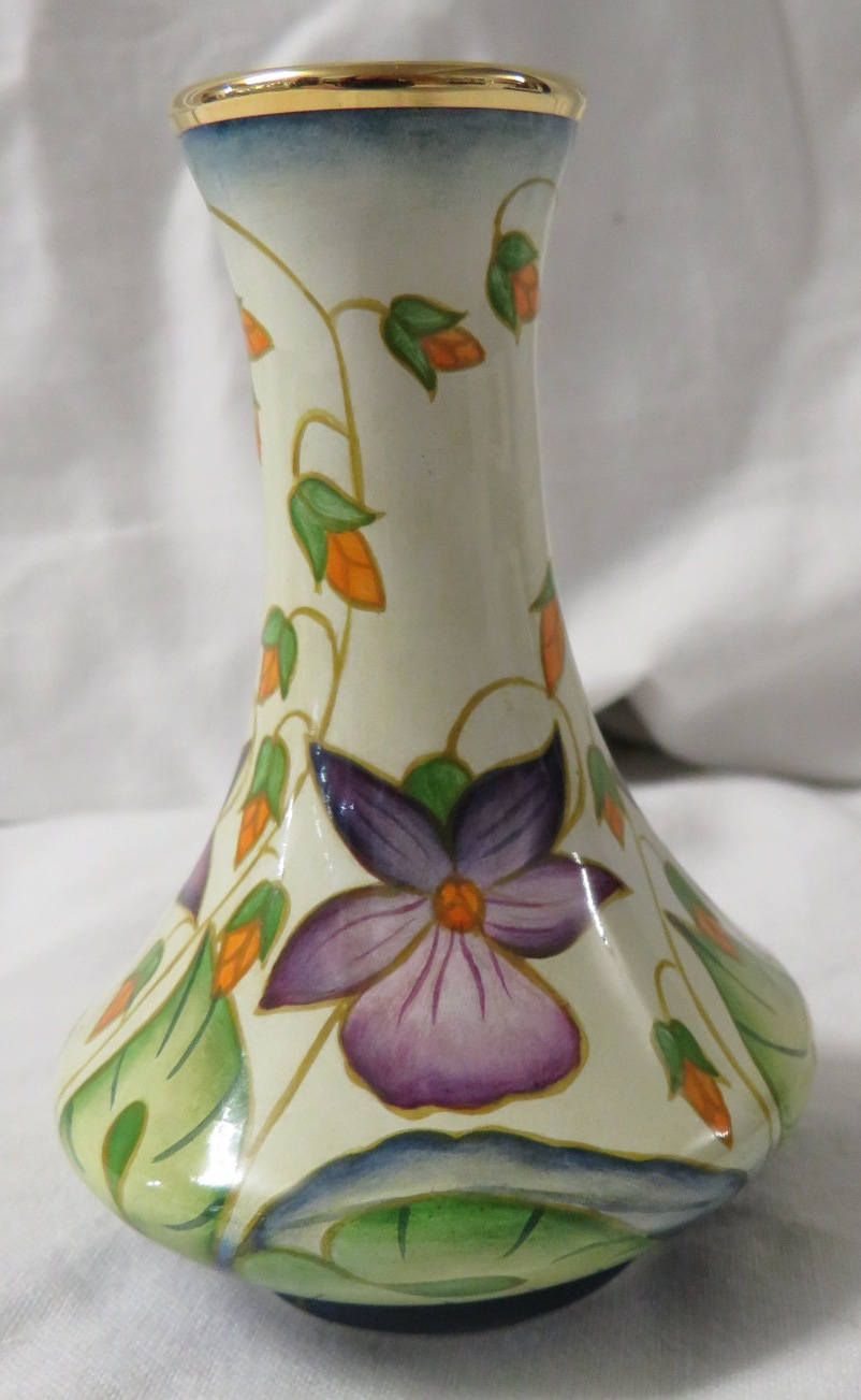 Lot 34 - Moorcroft enamel baluster vase, cream ground, purple flowers and trailing red buds and green leaves,