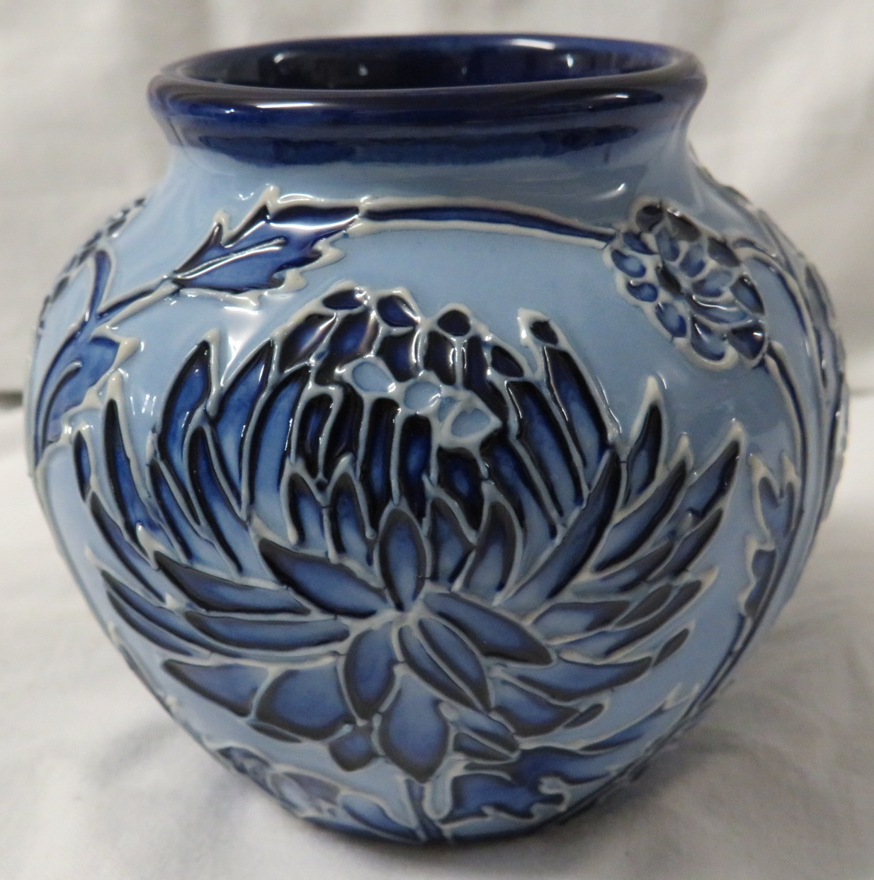 Lot 11 - Moorcroft pottery small ovoid vase in the style of Macintyre Florian ware, pale blue with tube lined