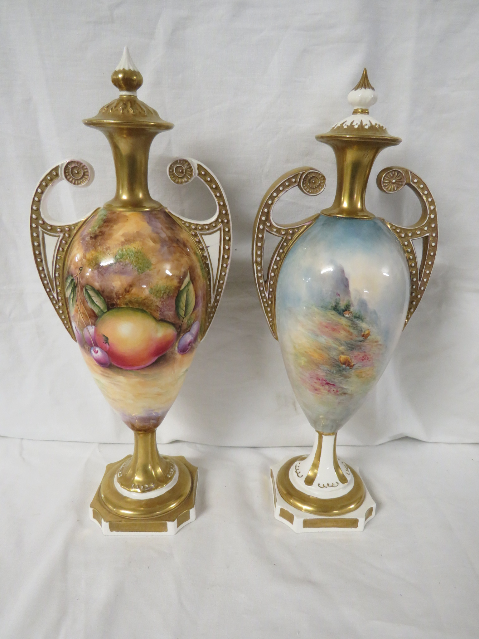Lot 40 - Two David Bowkett Ceramics porcelain vases, urn shaped with two scrolled handles moulded with
