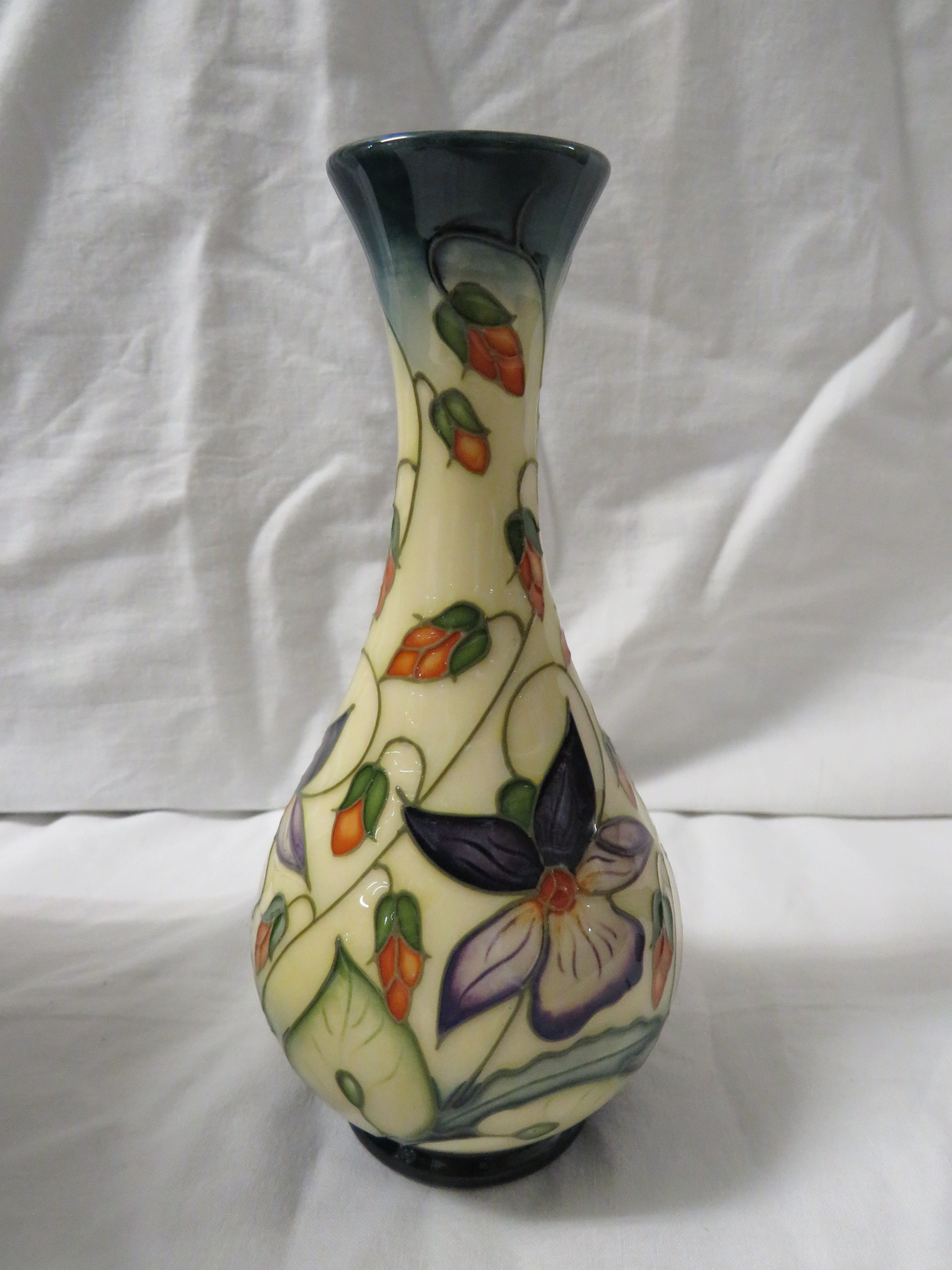 Lot 4 - Moorcroft pottery one star members vase of bottle shape, cream ground, green at neck and foot,
