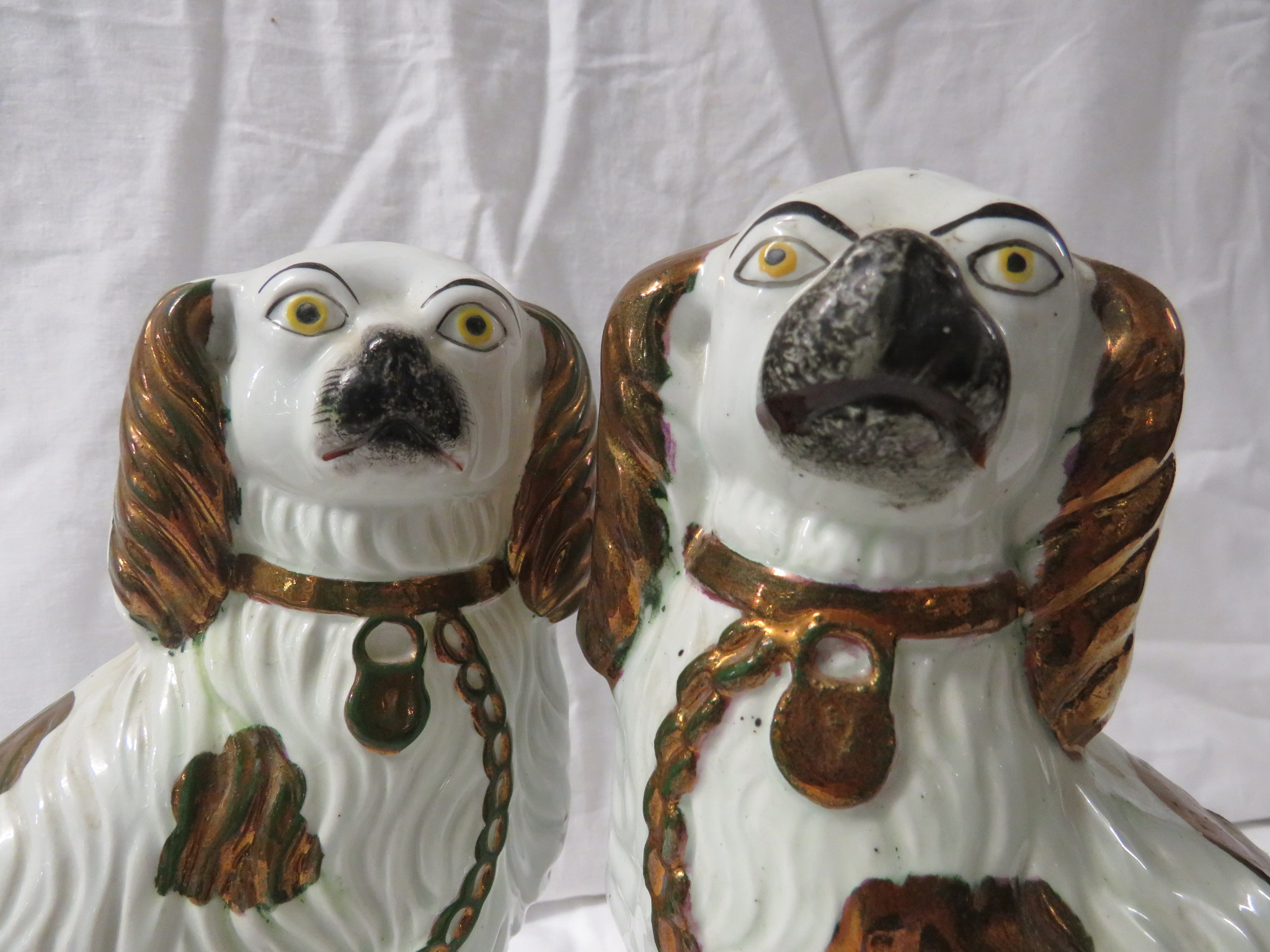 Lot 41 - A pair of Staffordshire style pottery spaniel dogs, 23cm