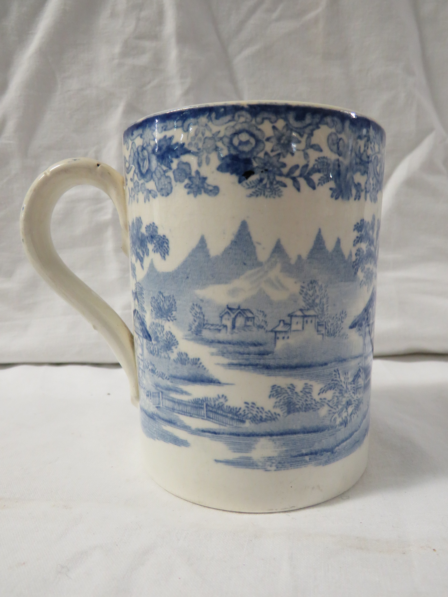 Lot 44 - A Victorian Davenport blue and white transfer decorated pottery pint tankard