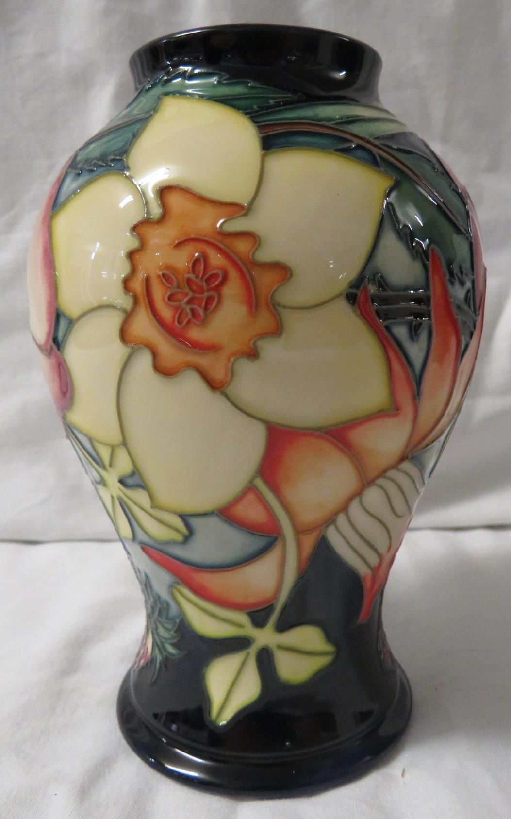 Lot 19 - Moorcroft pottery QEII Golden Jubilee baluster vase, dark blue ground, tube lined decoration of
