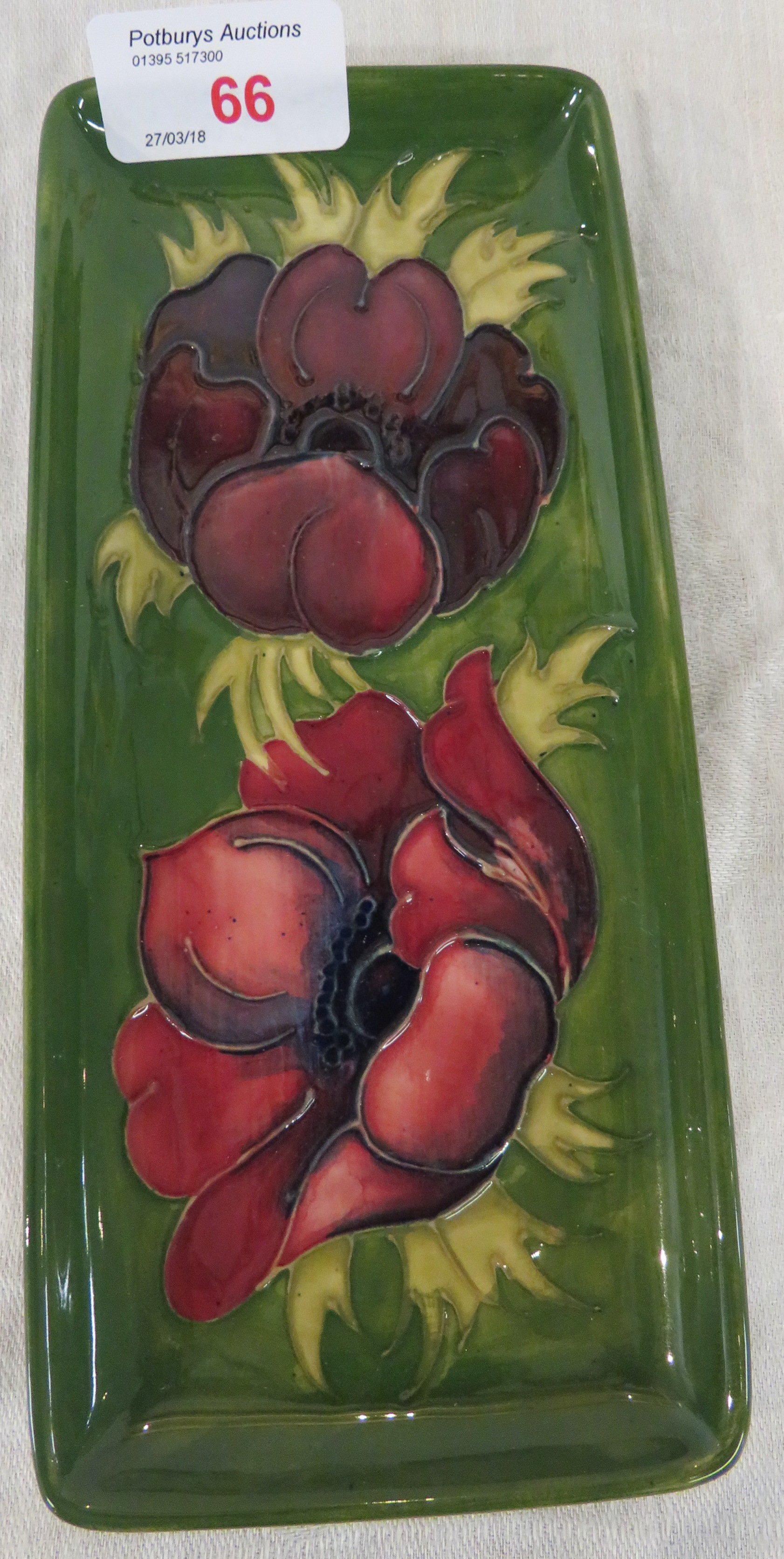 Lot 29A - Moorcroft pottery oblong dish, green ground, tube lined decoration of crimson poppies, stamped MOOR