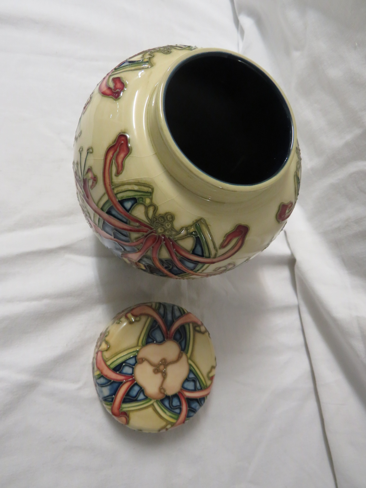 Lot 9 - Moorcroft pottery ginger jar with cover, cream ground, tube lined decoration of honeysuckle and