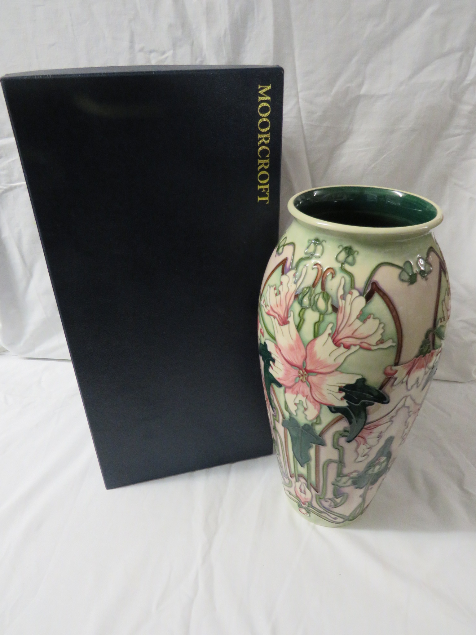 Lot 28 - Moorcroft pottery tall ovoid vase, Blakeney Mallow pattern with pale green and lilac ground, tube