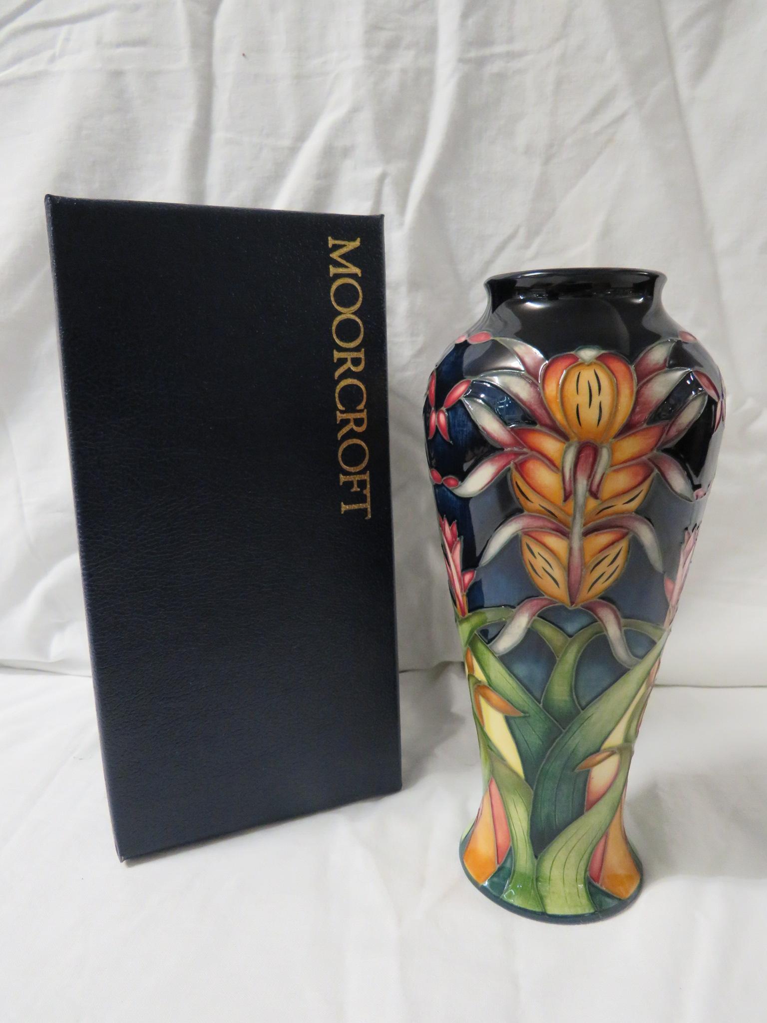 Lot 6 - Moorcroft pottery Lizard Orchid three star members vase, high shouldered baluster form, dark blue