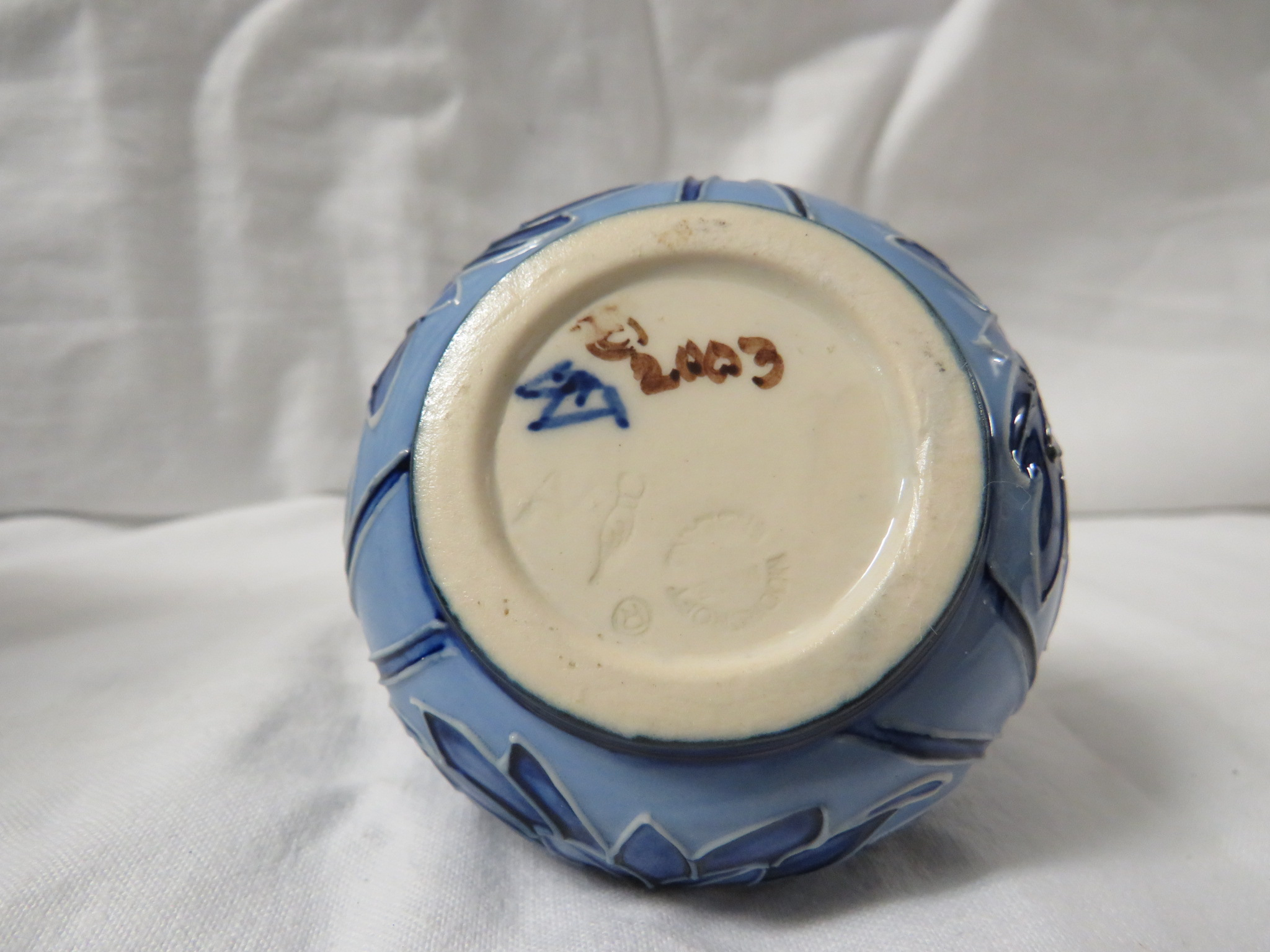 Lot 10 - Moorcroft pottery small squat vase in the style of Macintyre Florian ware, pale blue ground with