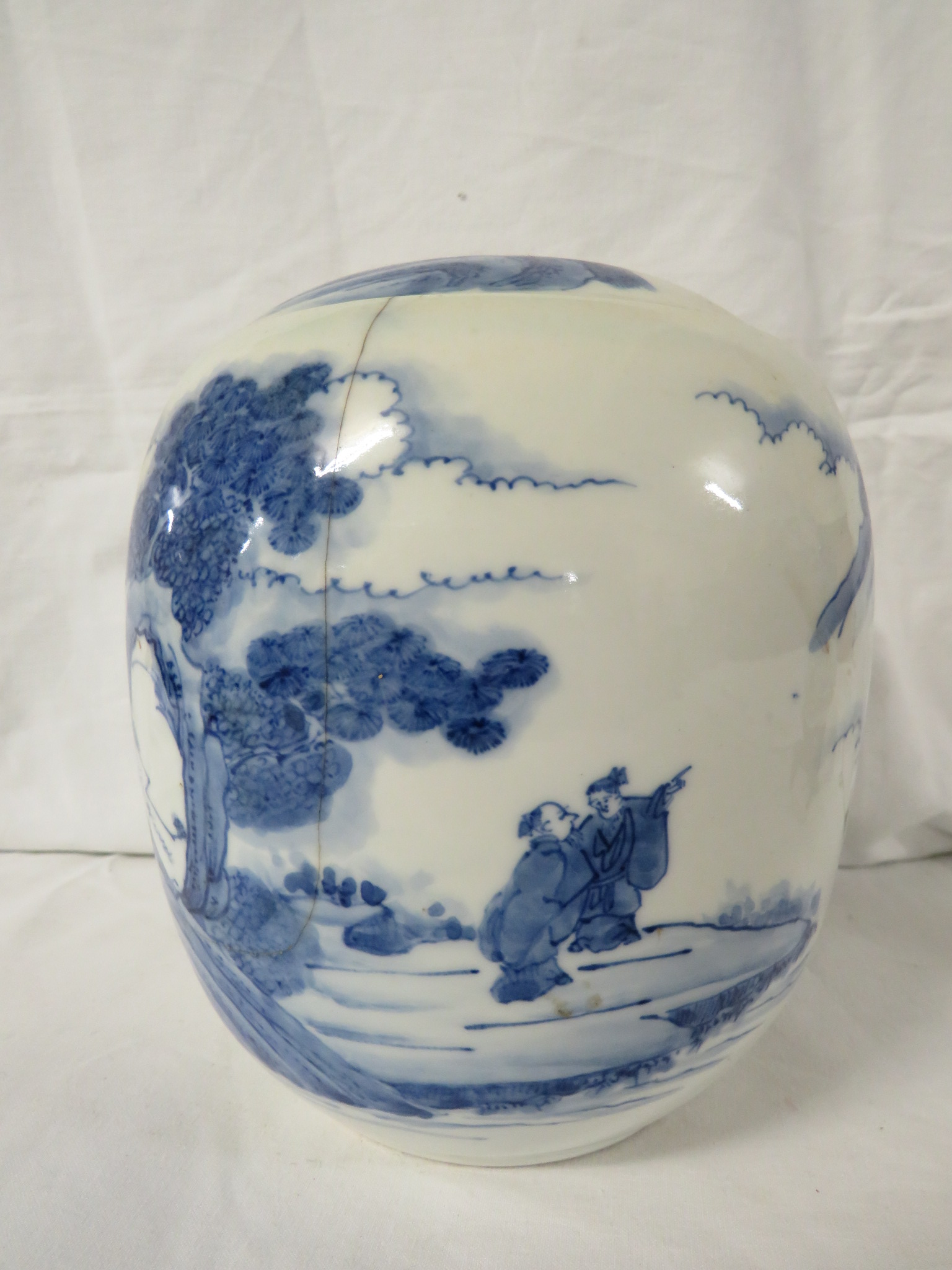 Lot 48 - A Chinese porcelain ovoid jar painted in underglaze blue with landscape with figures, height 17cm,