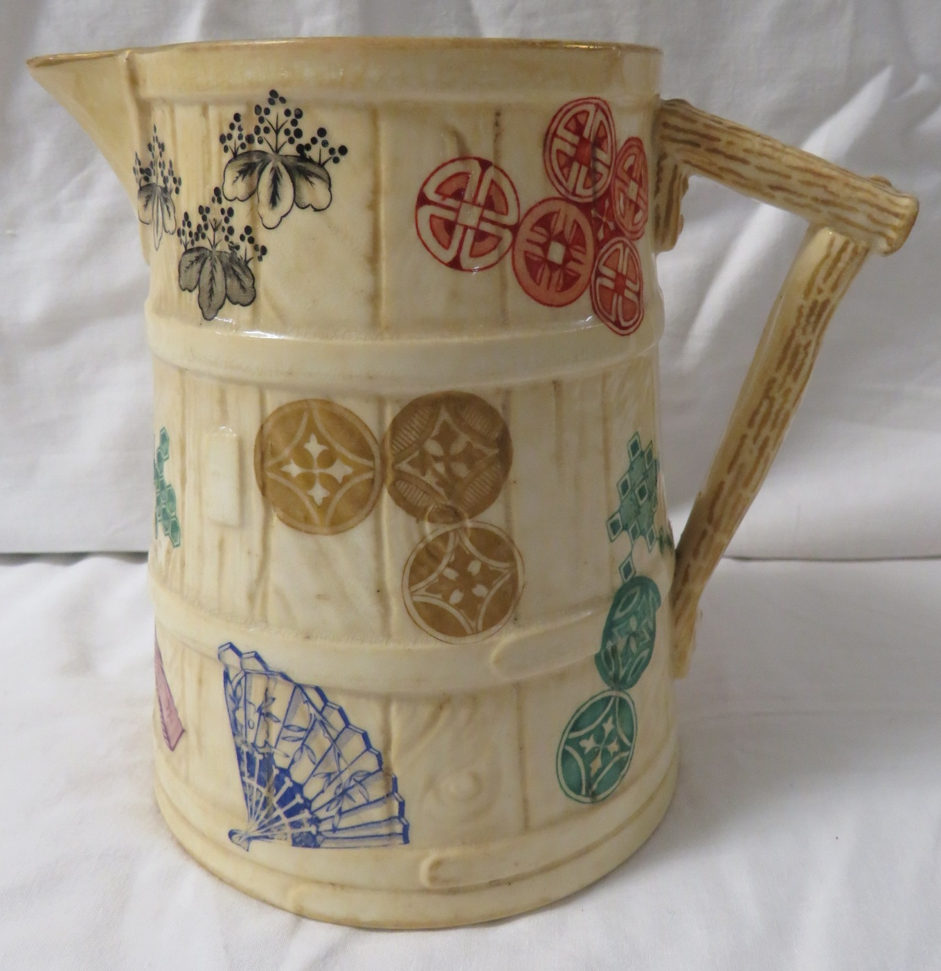 Lot 43 - Royal Worcester Aesthetic style jug with Japanese emblems, handle moulded as wood, green factory