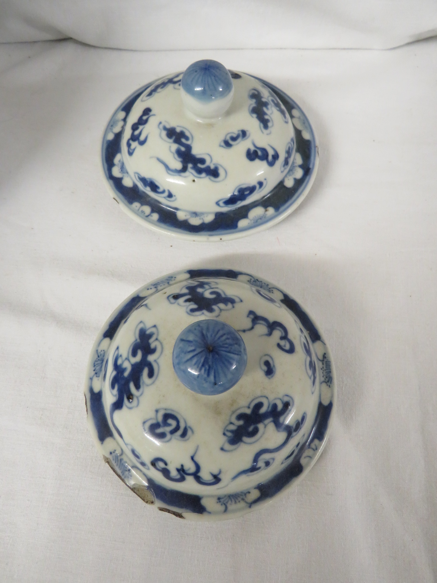 Lot 46 - A pair of Chinese porcelain gourd shaped jars, decorated in underglaze blue with an opposed pair