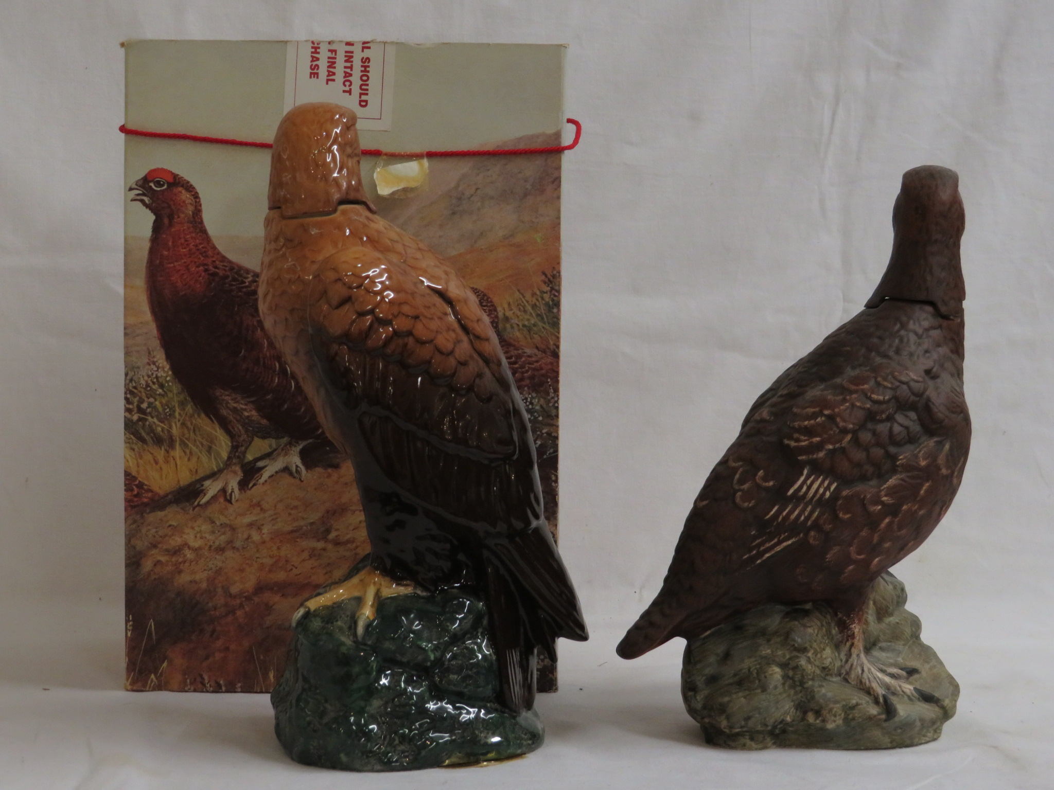 Lot 57 - Boxed Royal Doulton Scotch whisky decanter 'The Famous Grouse finest Scotch whisky', 70cl; and Royal