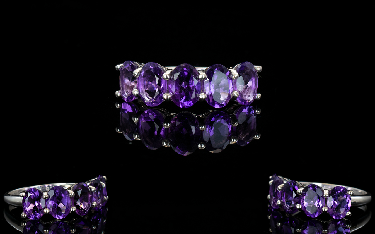 Lot 136 - A Sterling Silver And Amethyst Set Ring