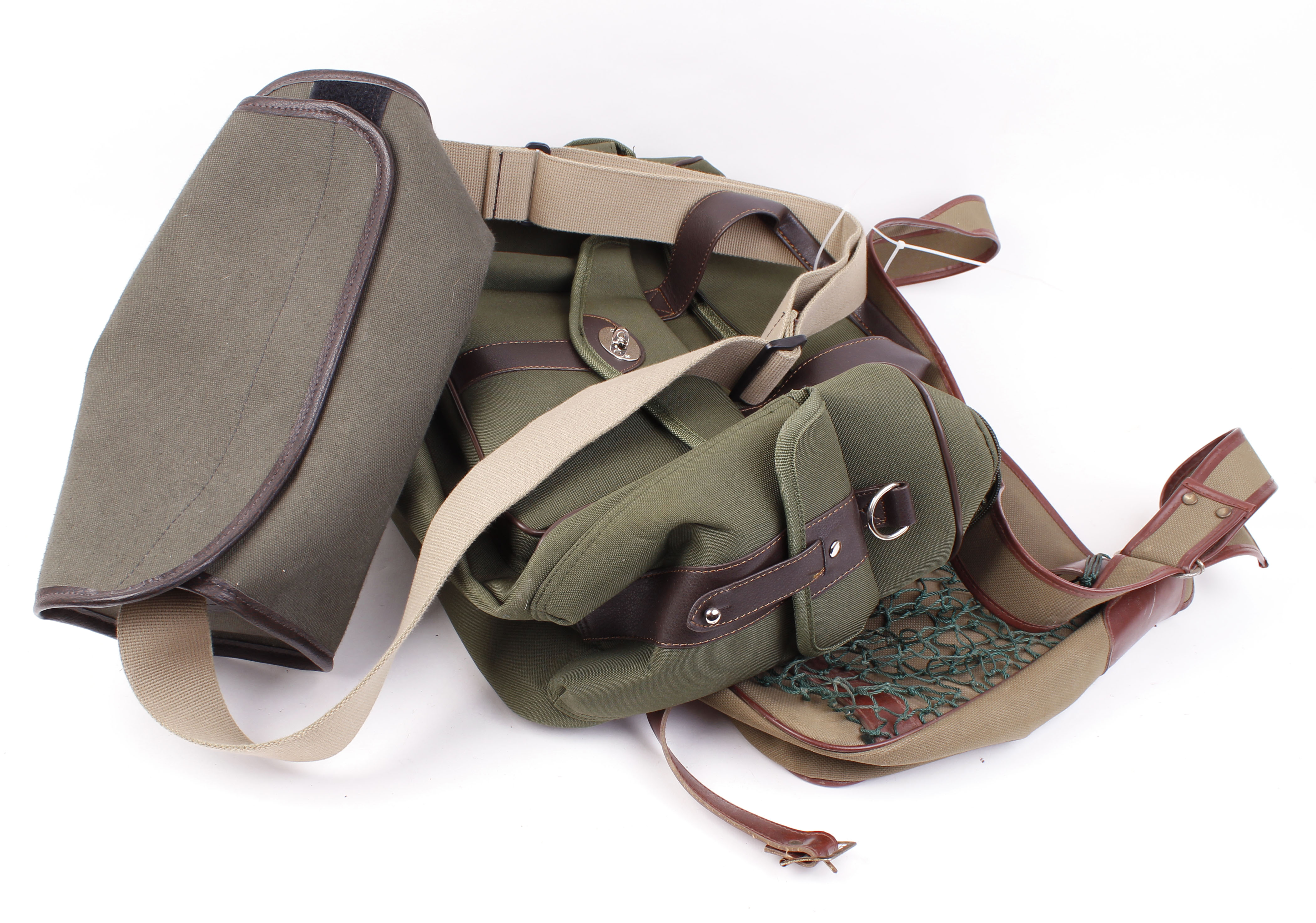 Lot 12 - Grey canvas cartridge bag with webbing strap; two game bags, as new