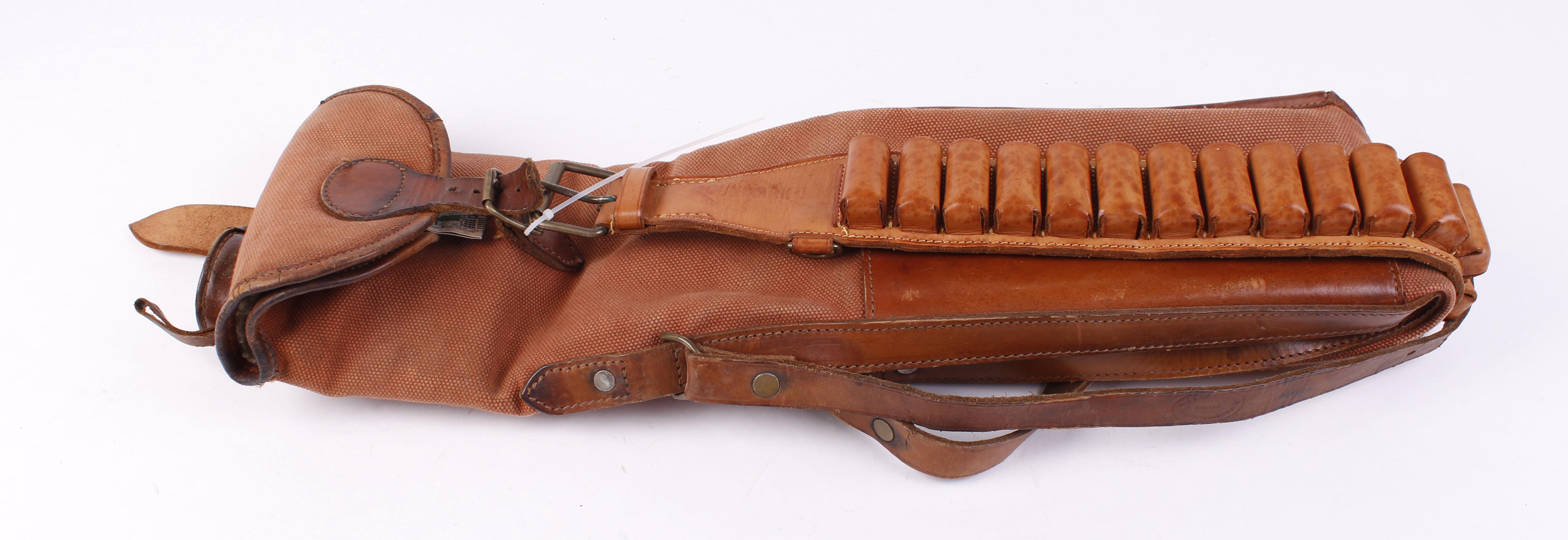 Lot 49 - Gunmark tan leather 12 bore cartridge belt; Canvas and leather fleece lined 48 ins gun slip