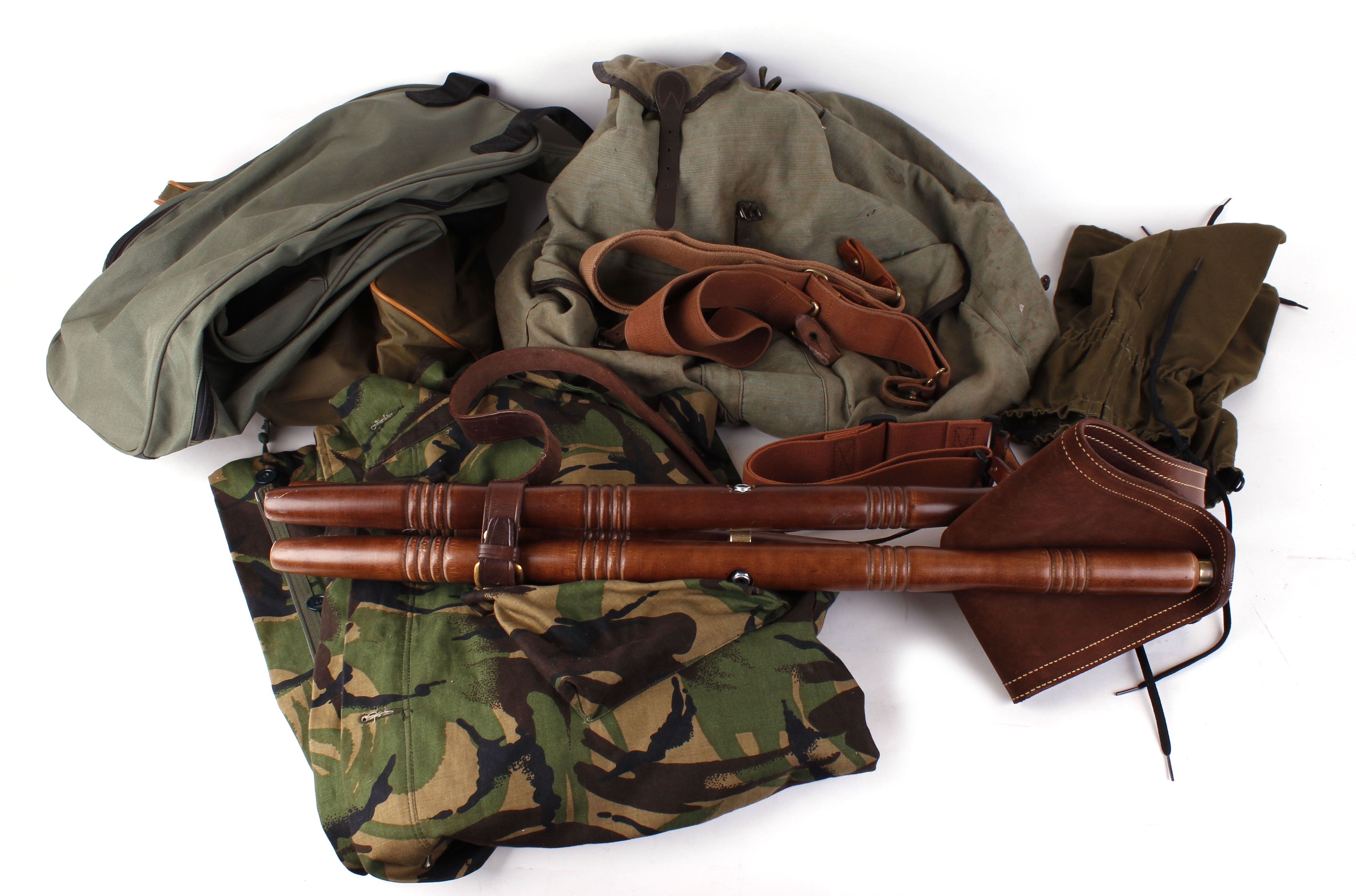 Lot 7 - Green canvas rucksack, two boot bags, camouflage shooting jacket, pair green gaiters, pair canvas
