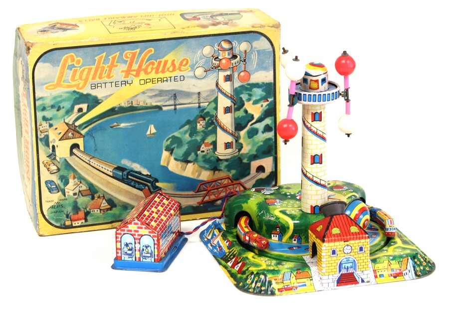 Lot 13 - Light House: A boxed, mid-20th century, battery operated, tinplate, Light House, Made by Alps,