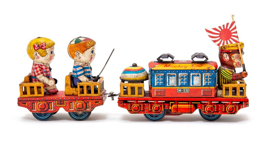 Lot 46 - Monkey Line Train: A clockwork, tinplate, Monkey Line Train, pulling a carriage with two children