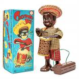 Calypso Joe: A boxed 1950's battery operated, remote control, tinplate, Calypso Joe, Made by Linemar
