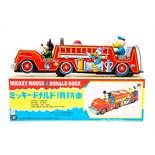 Mickey Mouse: A boxed, battery operated, tinplate, Mickey Mouse & Donald Duck Fire Engine, Made by