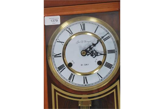 A James C Huntington Wall Clock Having A 31 Day Movement With Enamel Face Faceted Hands And Roma